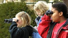 children using binoculars to watch birds. Photo by Katie Humason.